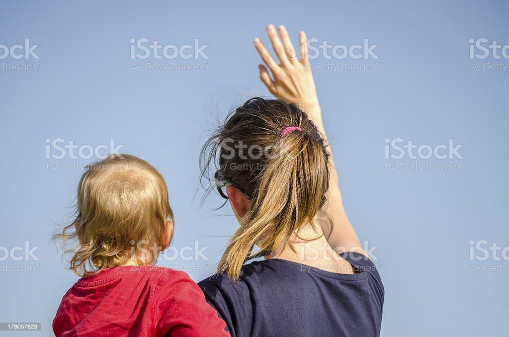 Mum and son waving stock photo