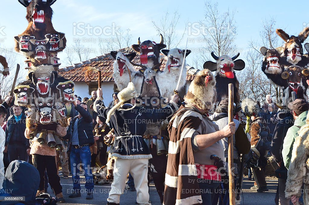 Mummers with sheepskin costumes and scaring dragoon masks stock photo