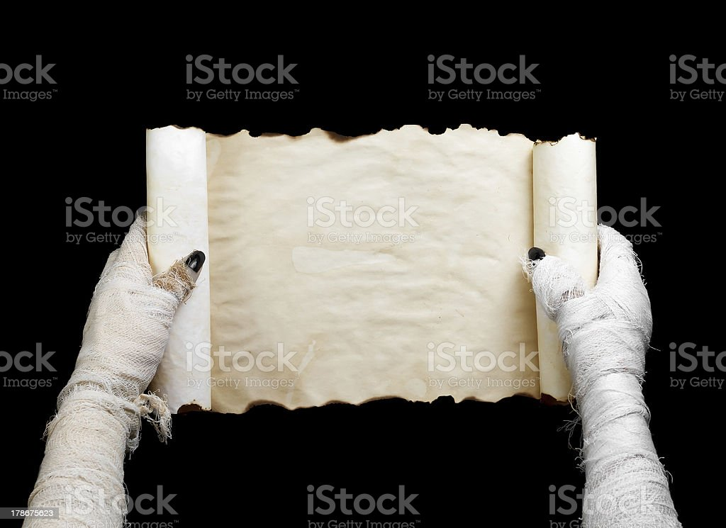 Mummy in hands keeps manuscript royalty-free stock photo