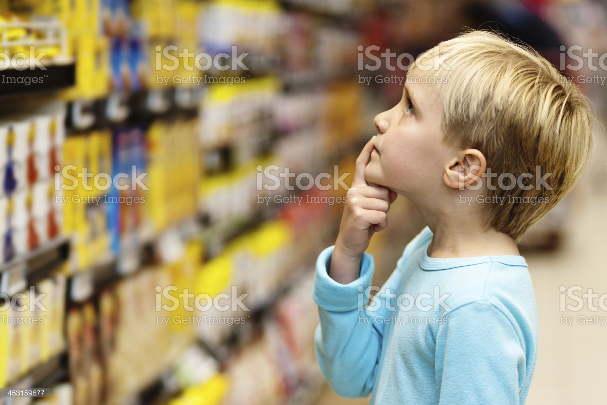 Mummy said to get the cereal but I can't reach! royalty-free stock photo