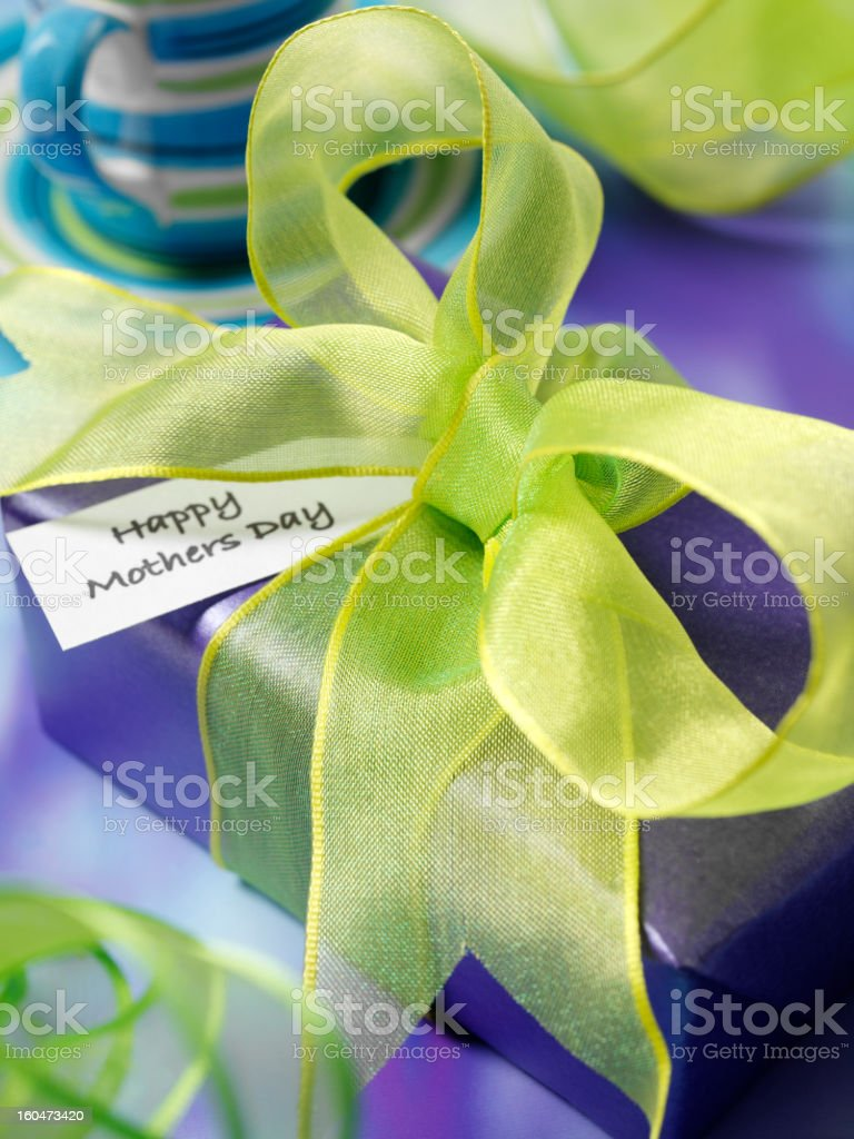 Mum's Special Day Present Wrapped in Purple and Green royalty-free stock photo