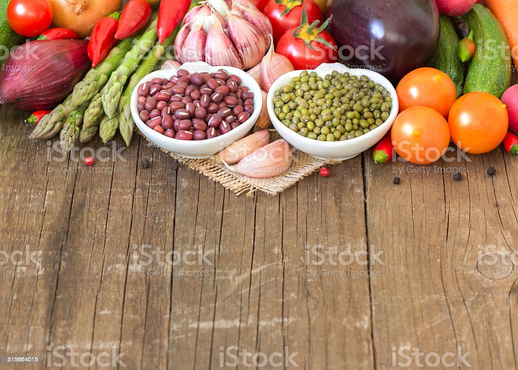 Mung and azuki beans in a bowl and vegetables stock photo