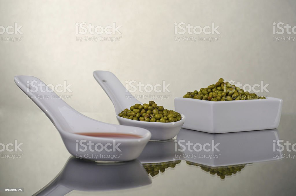 Mung beans in a ceramic bowl royalty-free stock photo