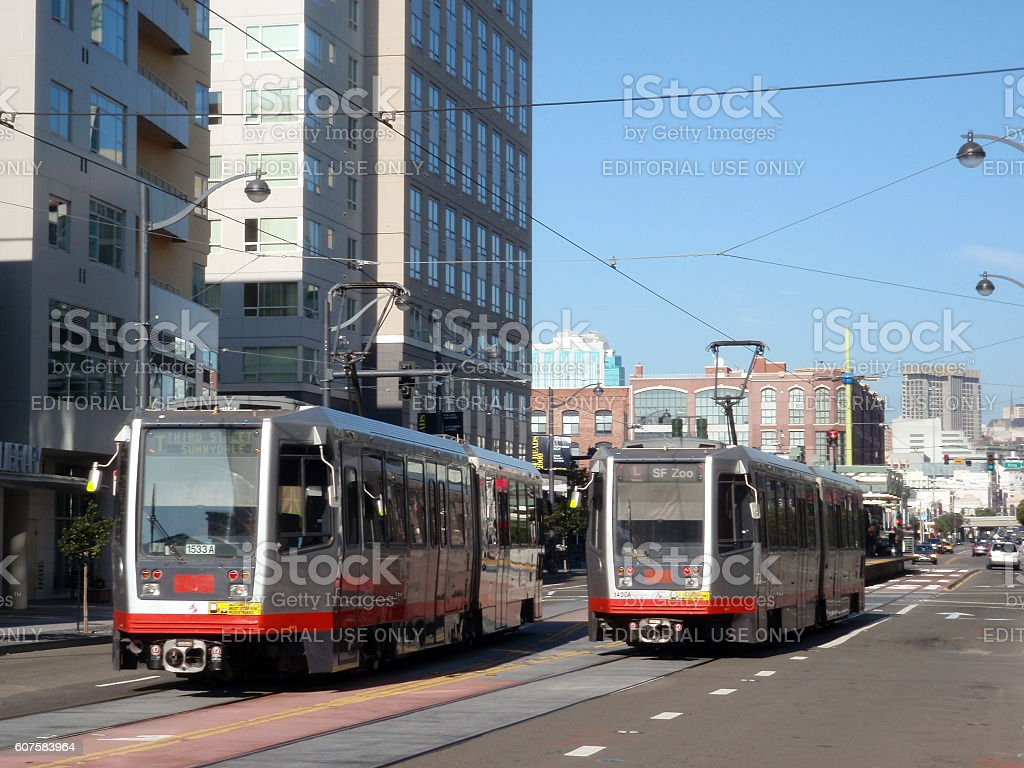 Muni Light-rail trains pass each other going in opposite directi stock photo