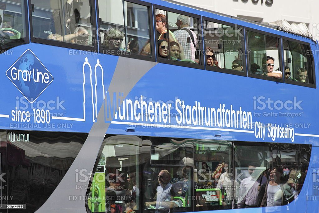 Munich: Double-decker bus with tourists stock photo