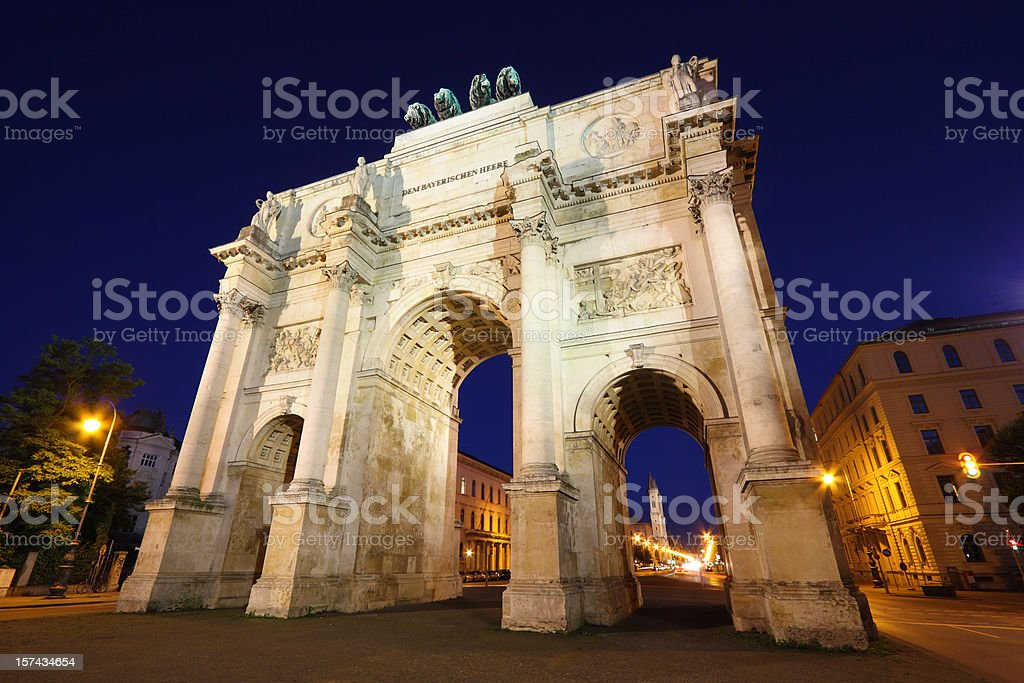 Munich Siegestor (Victory Gate), University and Ludwigstrasse at  dusk royalty-free stock photo