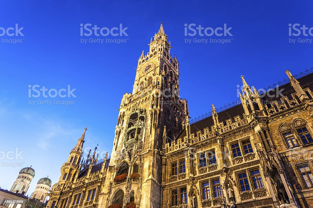 Munich town hall in the night stock photo