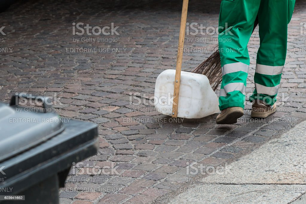 Municipal Dustman Worker with Cleaning Tools stock photo