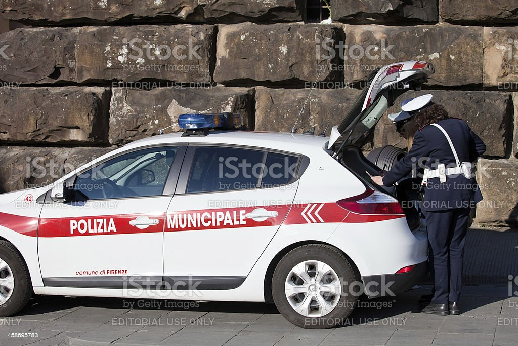 Municipal police while checking the documents and wrote a fine royalty-free stock photo