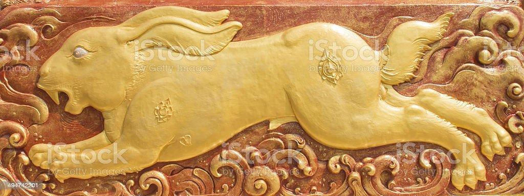 Mural Golden rabbit stock photo