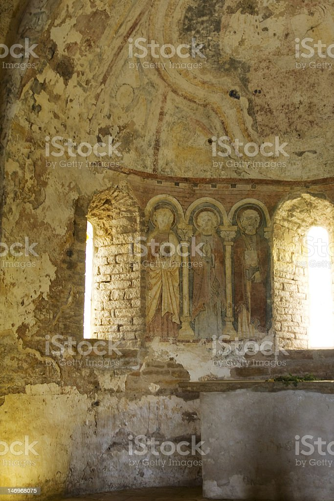 Mural on wall of old medieval church in France stock photo