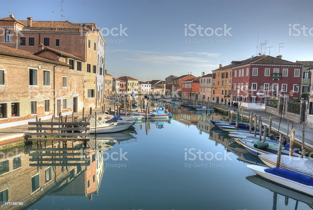 Murano blue water and boats stock photo
