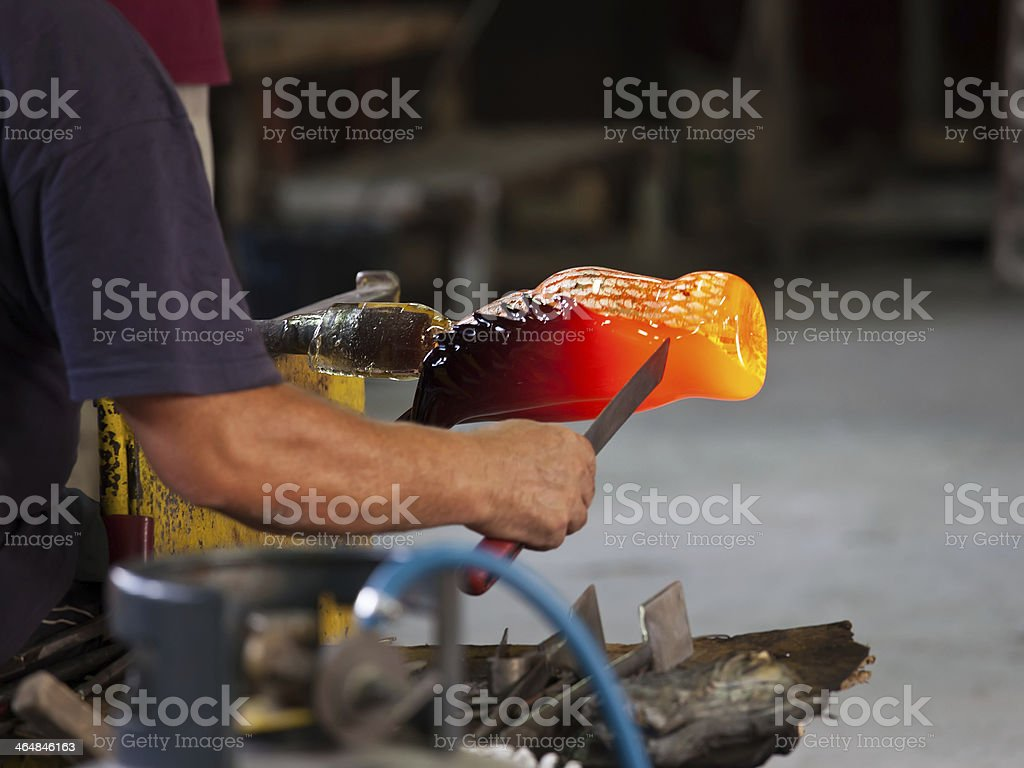 A Murano glass being crafted by experienced glass-blowers stock photo