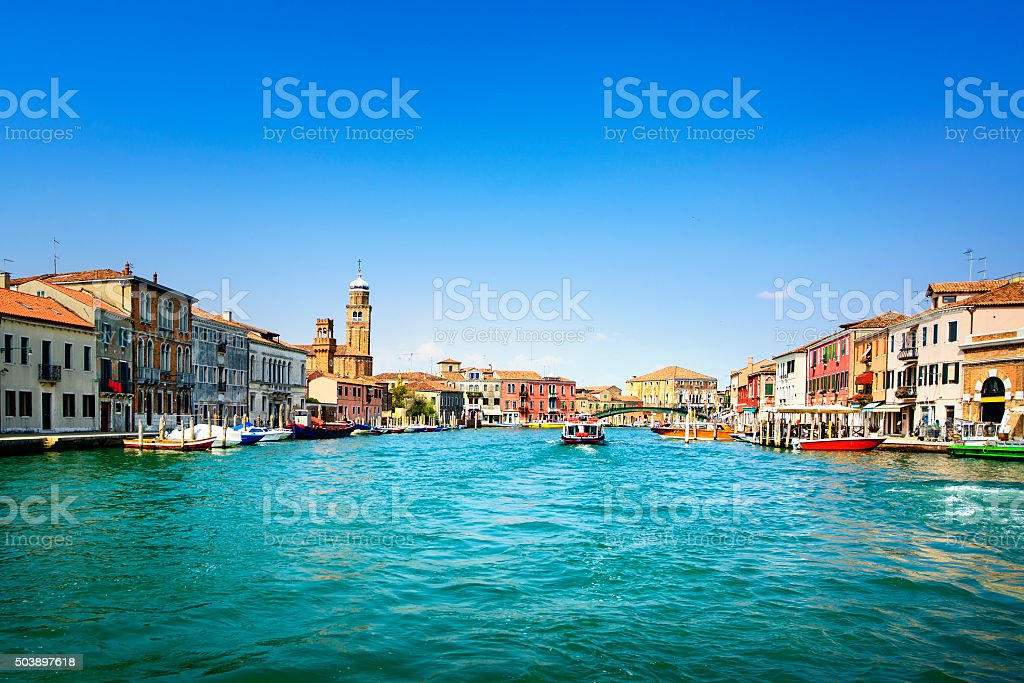 Murano glass making island, water canal and buildings. Venice, I stock photo