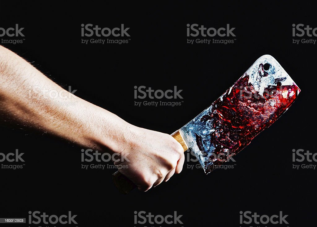 Murder or meat preparation? Hand grips blood-stained knife. stock photo