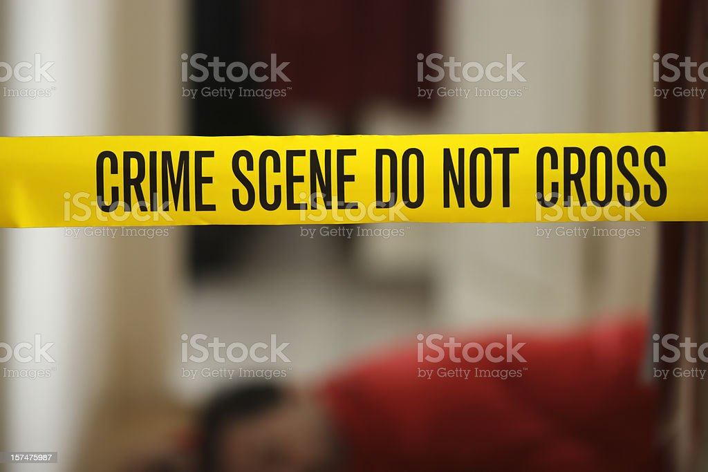 CSI: Murder victim and crime scene tape stock photo