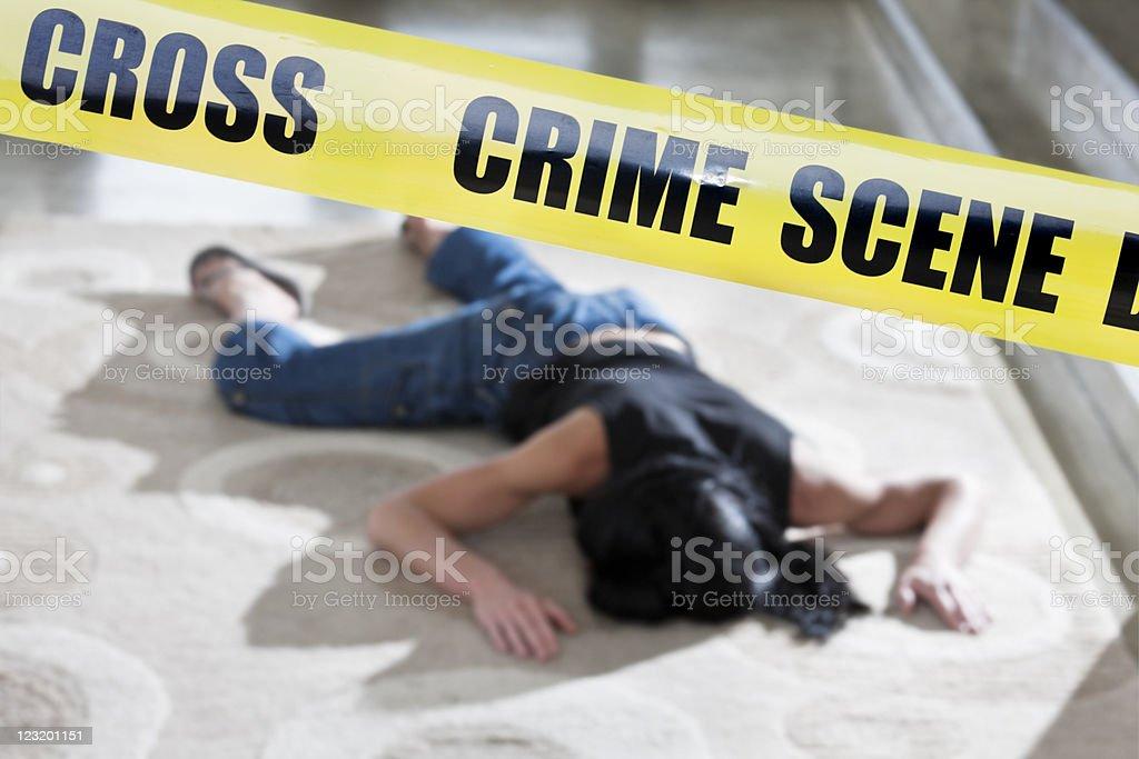 Murder victim behind police cordon tape stock photo