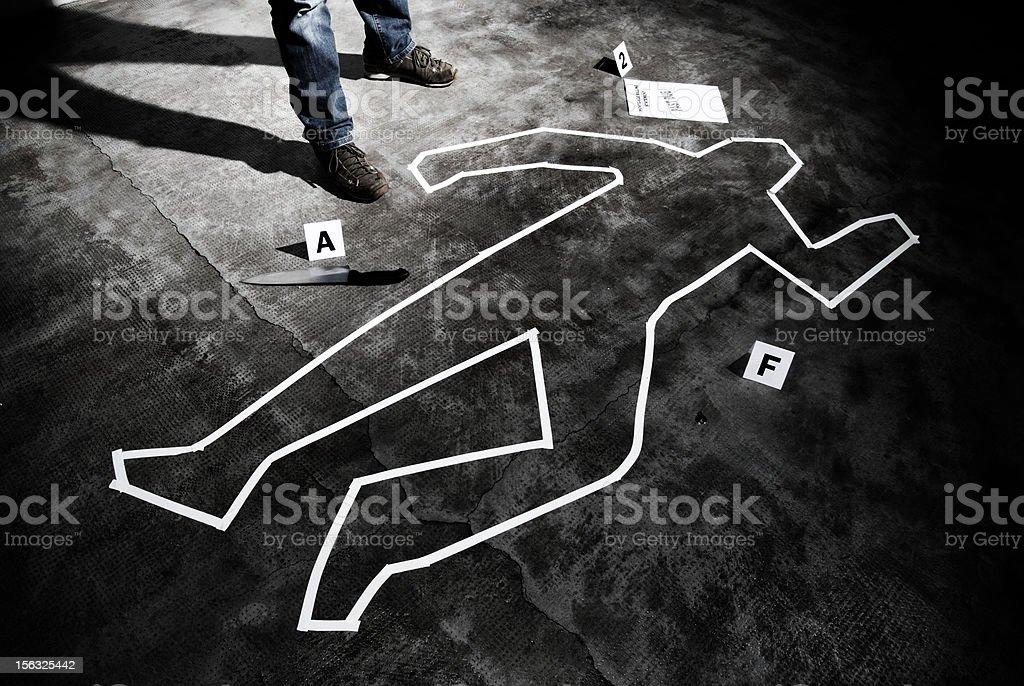Murderer back on the crime scene stock photo