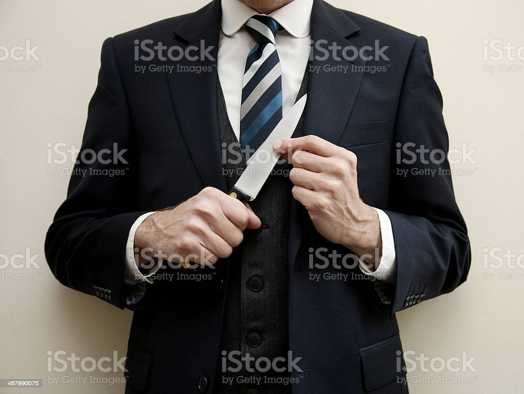 Murderous businessman stock photo