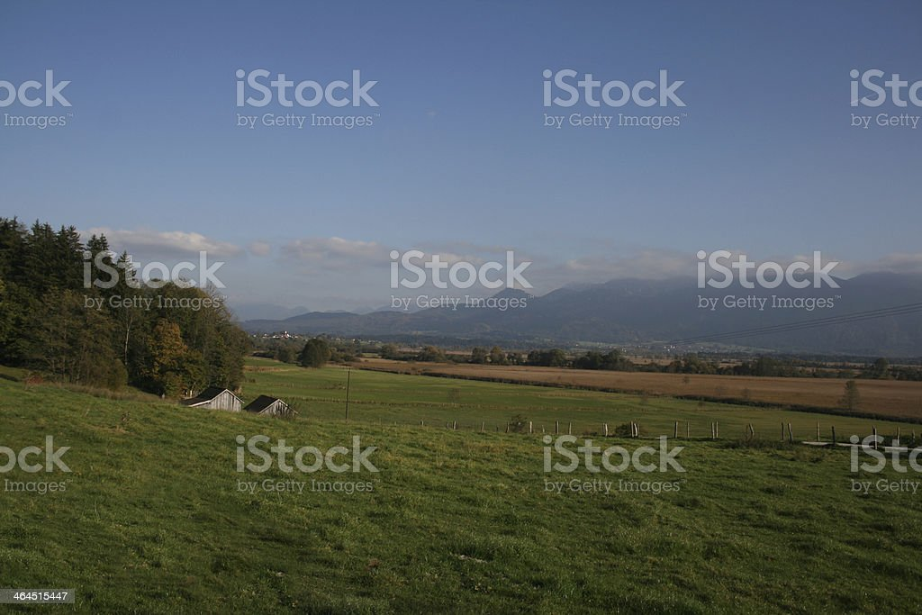 Murnauer Moos with farmers meadow stock photo