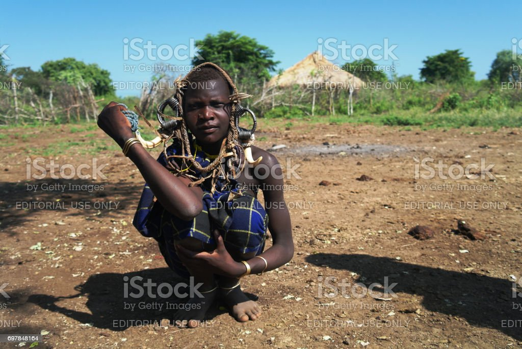 Mursi tribe woman - 05 october 2012 , Omo valley, Ethiopia stock photo