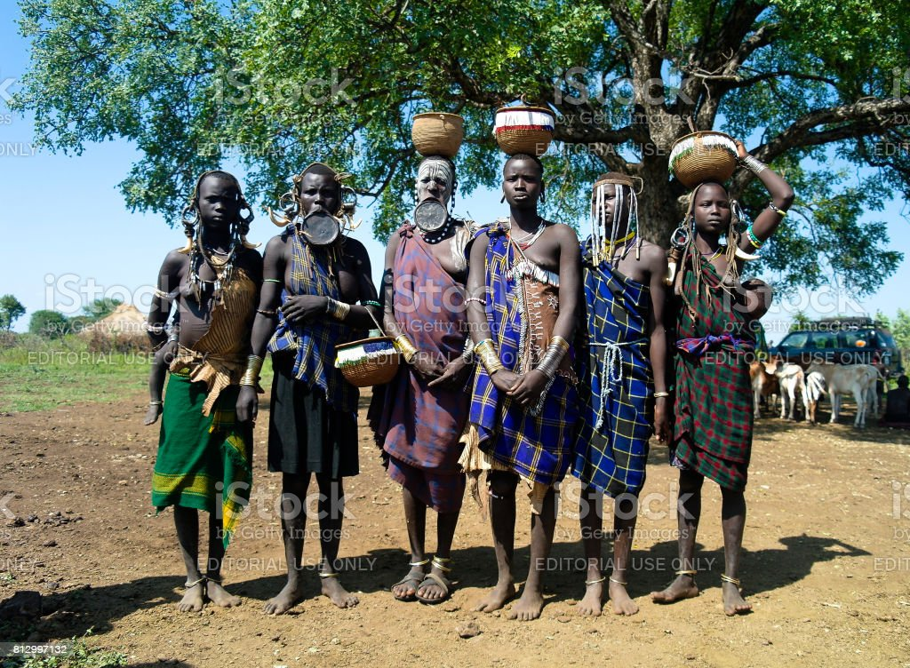 Mursi tribe women with baby Omo valley, Ethiopia stock photo