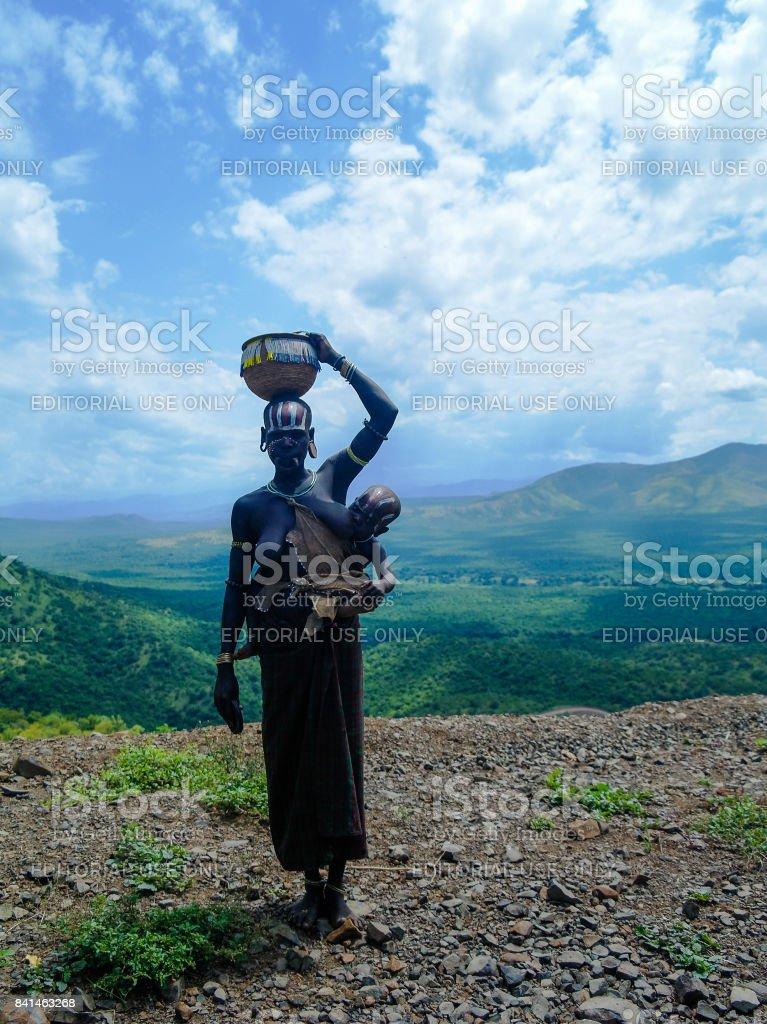 Mursi tribe women with baby Omo valley, Ethiopia stock photo