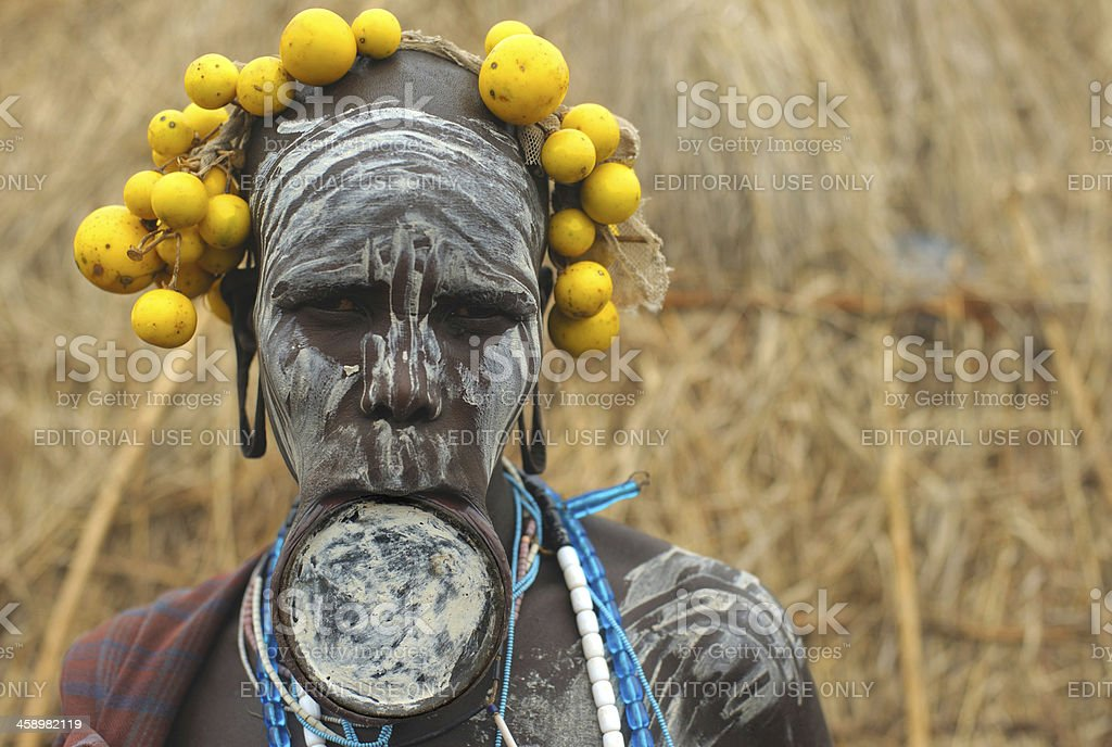 Mursi woman with lip plate and body painting stock photo