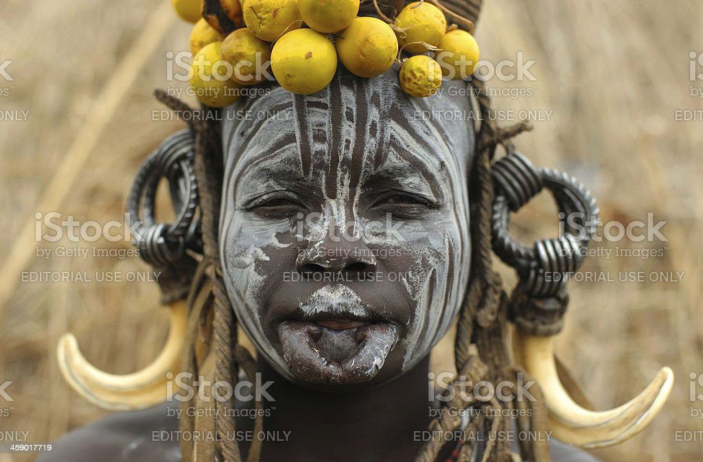 Mursi woman with painted face and traditional headdress stock photo