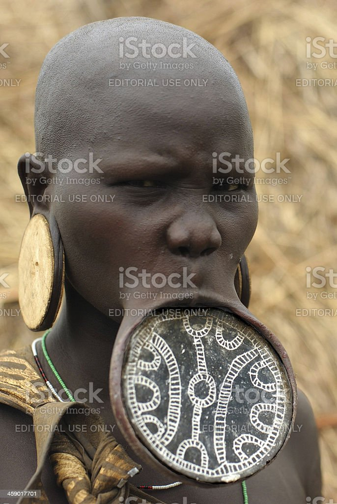 Mursi woman with traditional clay lip plate and giant earrings stock photo