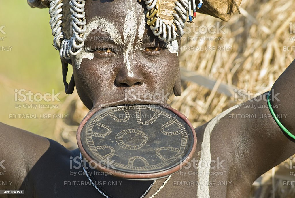 Mursi woman with traditional lip plate in Southern Ethiopia stock photo