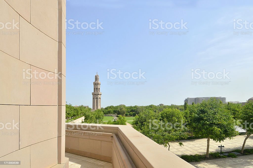Muscat Grand Mosque Gardens and Minaret Skyline royalty-free stock photo