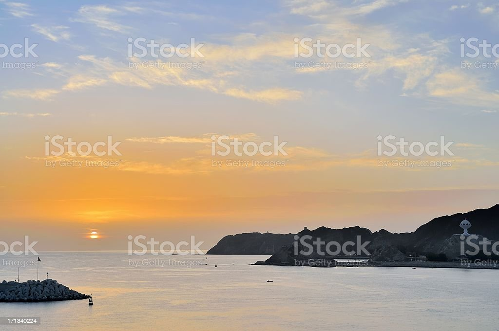 Muscat Harbor Entrance At Sunrise stock photo