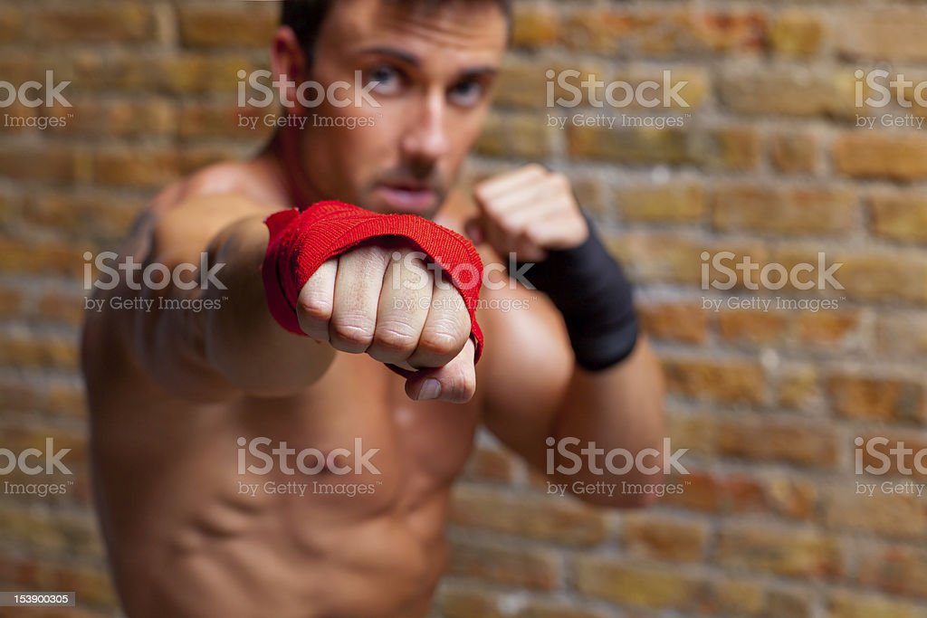muscle boxer shaped man with fist bandage royalty-free stock photo