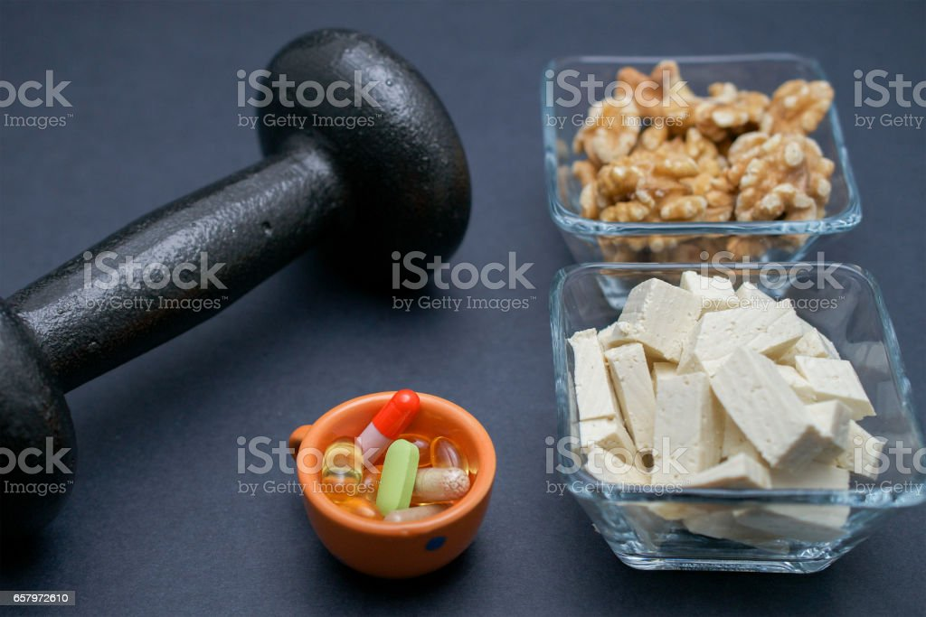 Muscle building on vegan protein stock photo