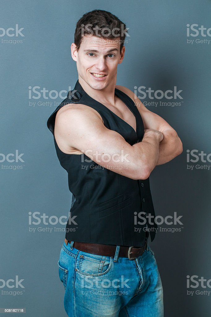muscle concept for cheerful young man stock photo