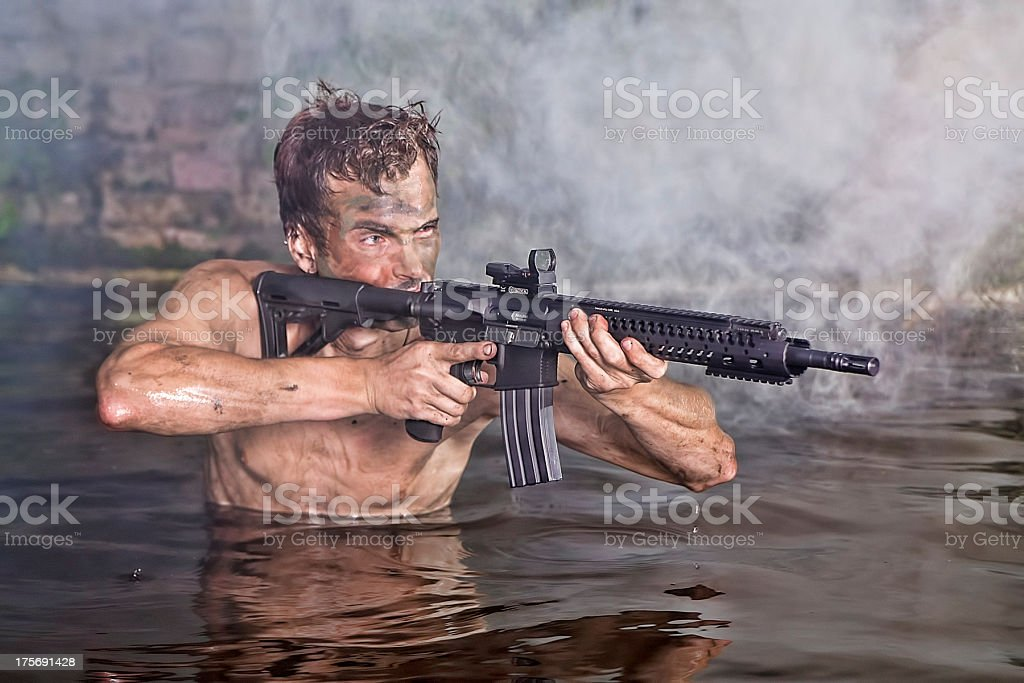 Muscle Man aims to shoot and kill stock photo