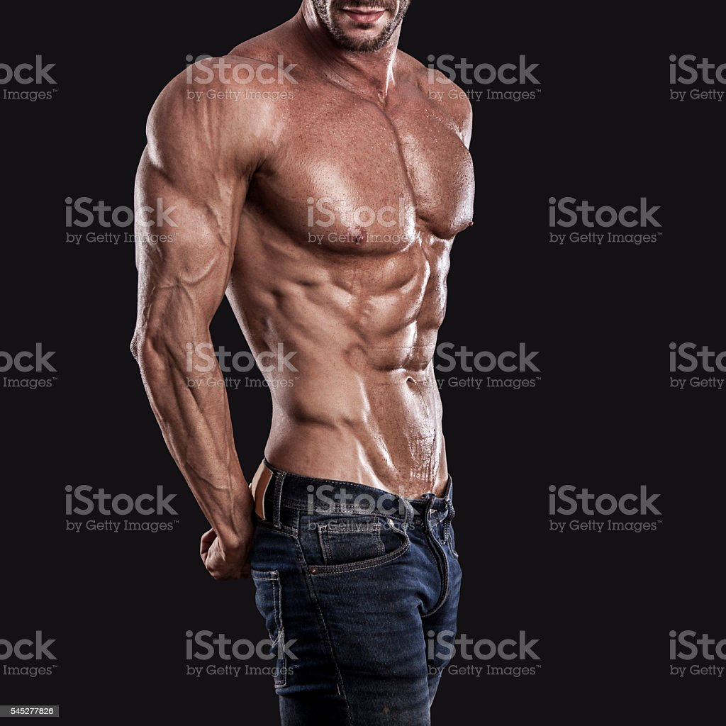 muscle man torso on black background, bodybuilding athlete stock photo