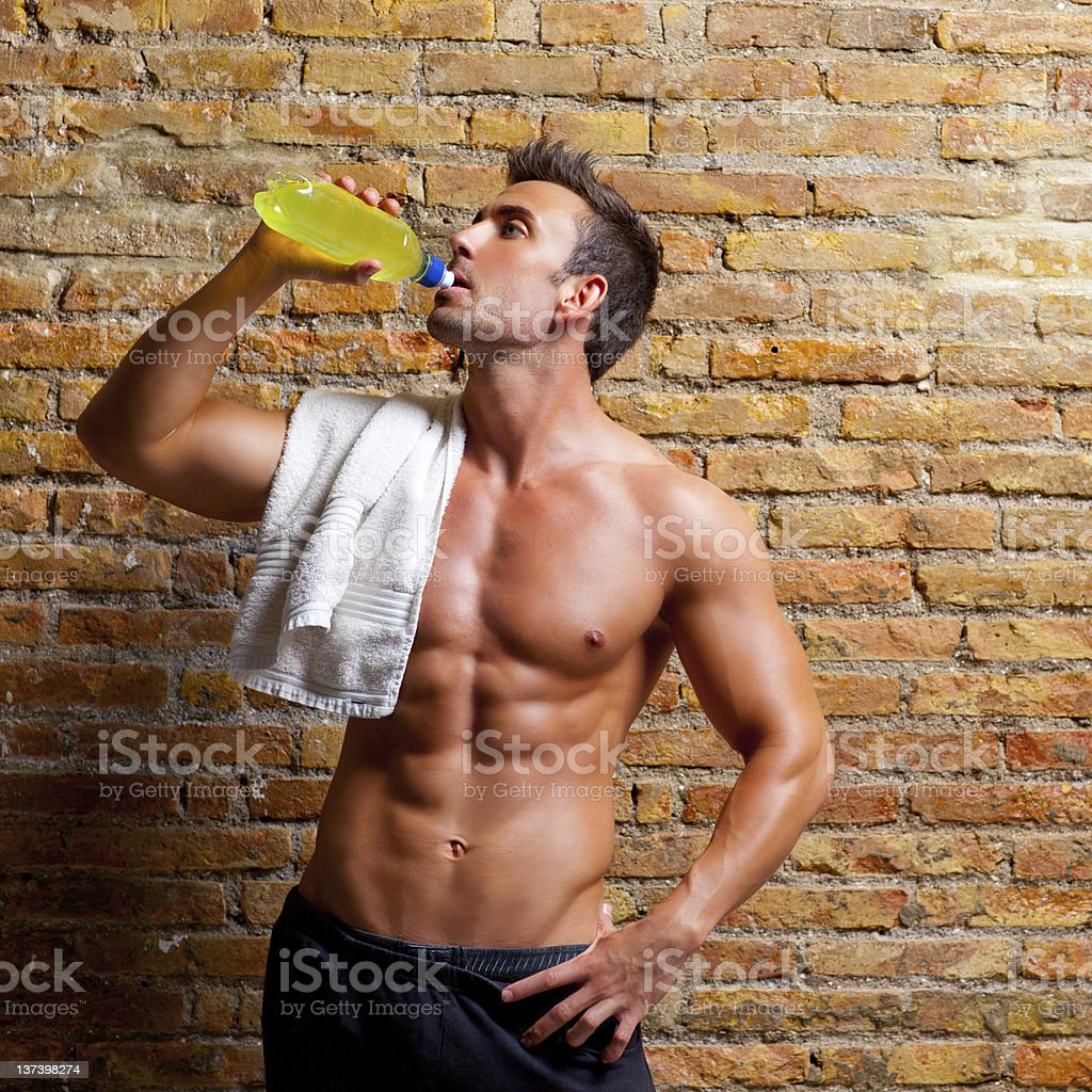 muscle shaped man at gym relaxed drinking royalty-free stock photo