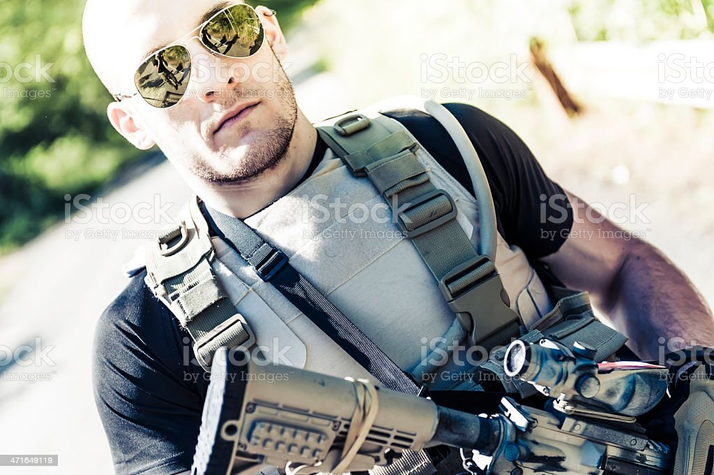 Muscled Handsome Modern Army Soldier Carrying Assault Rifle royalty-free stock photo