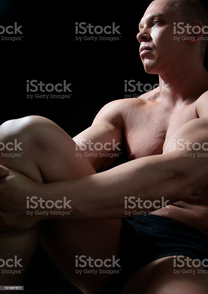 Muscled Man Kicking back royalty-free stock photo