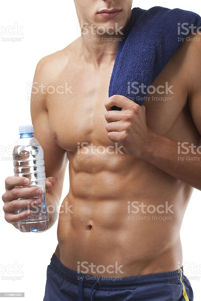 Musclura man holding towel and bottle of water stock photo