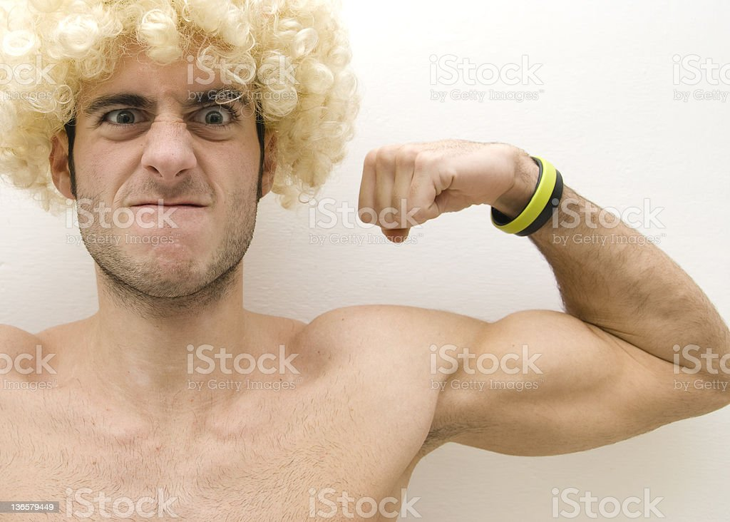 muscolar blonde man show his muscle royalty-free stock photo