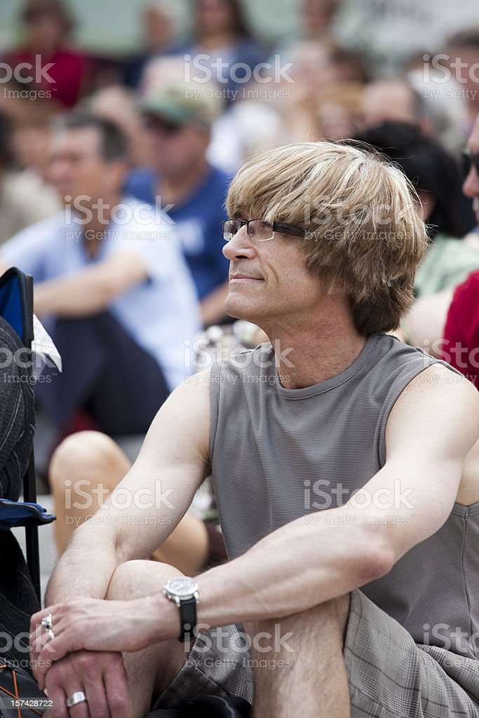 Muscular attractive man enjoys music at a jazz festival stock photo