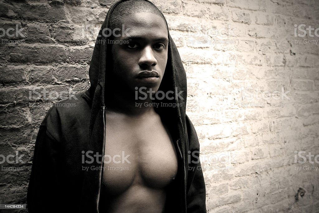 Muscular Black Man Against Brick Wall royalty-free stock photo