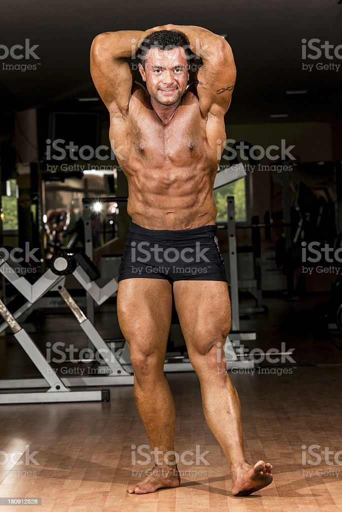 muscular body builder showing his front abdominal abs royalty-free stock photo