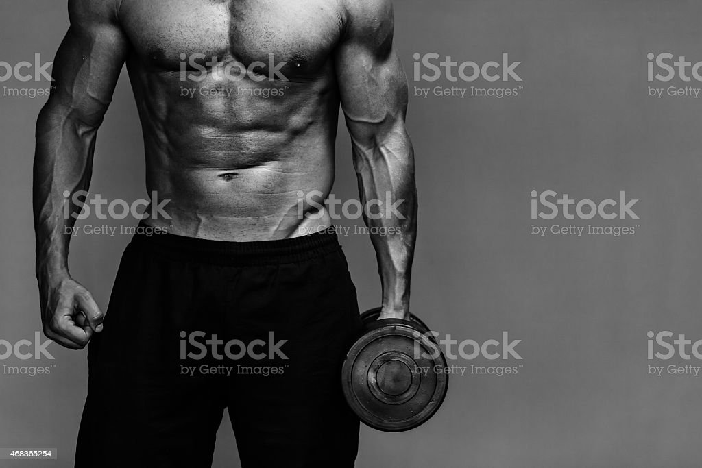 muscular bodybuilder guy close up monochrome stock photo