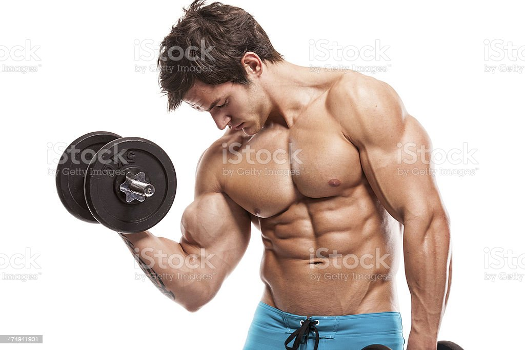 Muscular bodybuilder guy doing exercises with dumbbells over whi stock photo