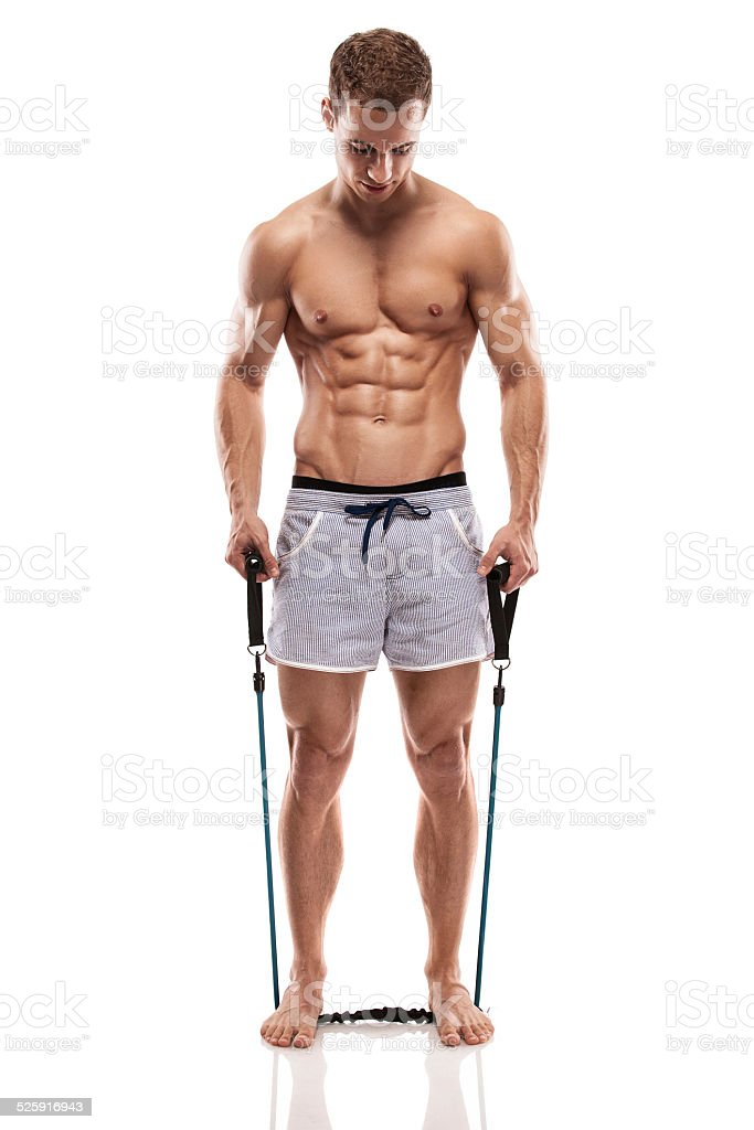 Muscular bodybuilder guy doing exercises with expander stock photo