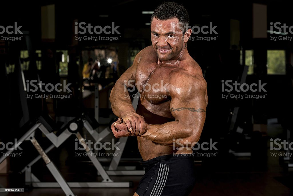 muscular bodybuilder showing his side chest royalty-free stock photo